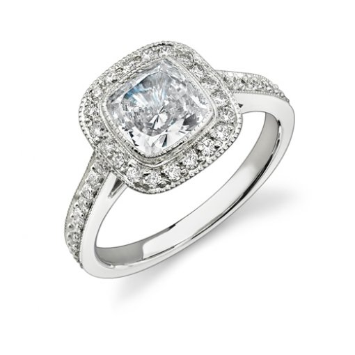 1.86ct Cushion Cut Bezel Halo Diamond Engagement Ring with Pave Diamonds on the side.