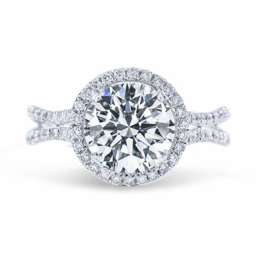 1.55ct Round Cut J SI1 Diamond in Double Halo Curved Split Shank French Pave setting.