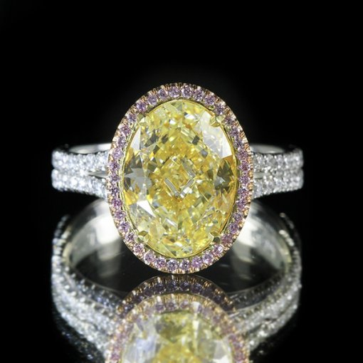 4.72ct of EGL Certified Oval Cut Fancy Intense Yellow Diamond in Rose Gold and Platinum Engagement Ring