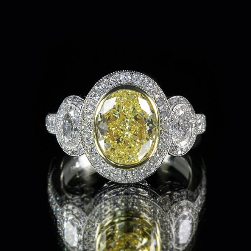 4.31ct of GIA Certified Oval Cut Fancy Yellow Diamond in 14K White Gold 3 Stone Pave Engagement Ring